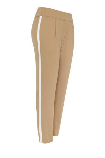 beżowe spodnie damskie dzianinowe z lampasem. Spodnie dresowe z nylonu i rayonu marki Vito Vergelis