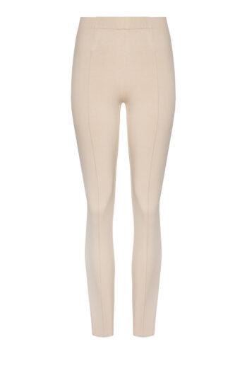 dzianinowe spodnie damskie beżowe na gumie z przeszyciami. Dres damski Vito Vergelis
