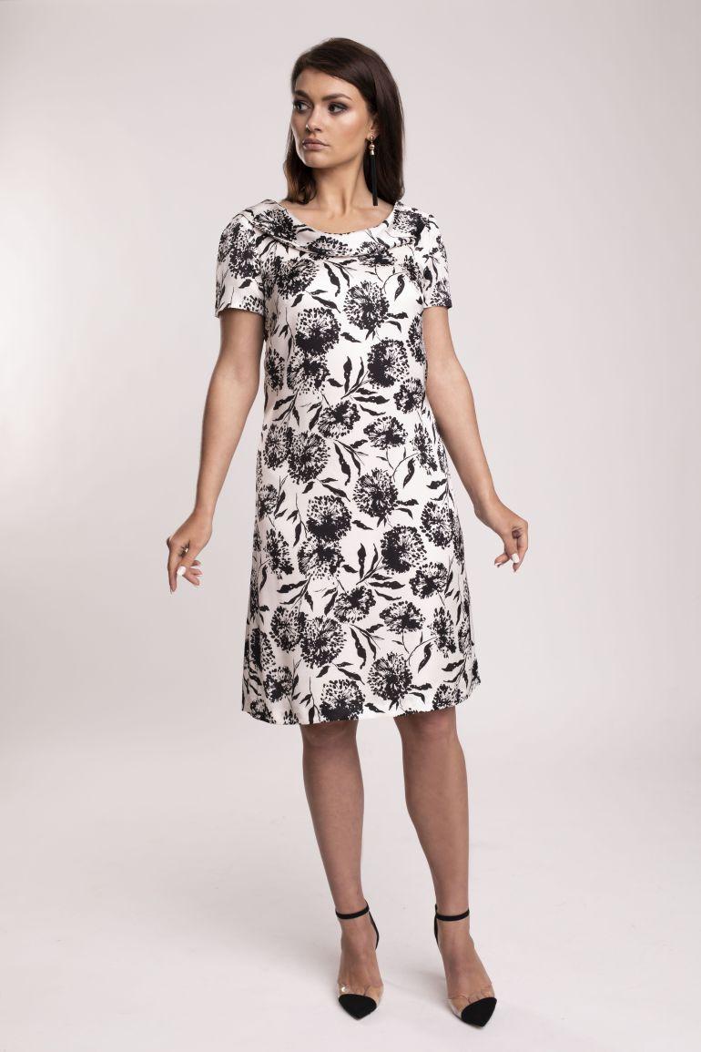 Elegancka, biała sukienka w czarne kwiaty z błyszczącej wiskozy. Sukienka marki Vito Vergelis