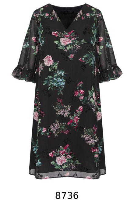 czarna sukienka w kwiaty z falbanami przy rękawach. Sukienka wizytowa Vito Vergelis